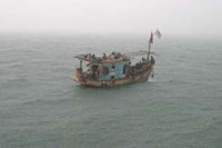 Vietnamese refugees escape on boat